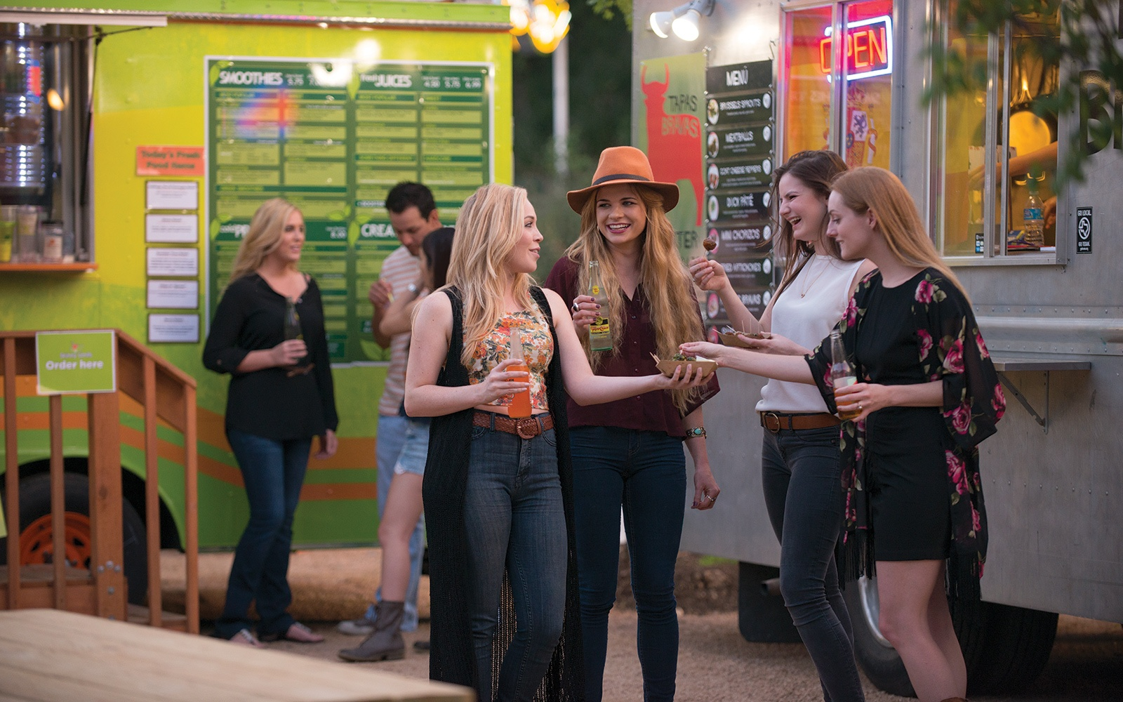 women standing in front of food trucks in Austin, Texas