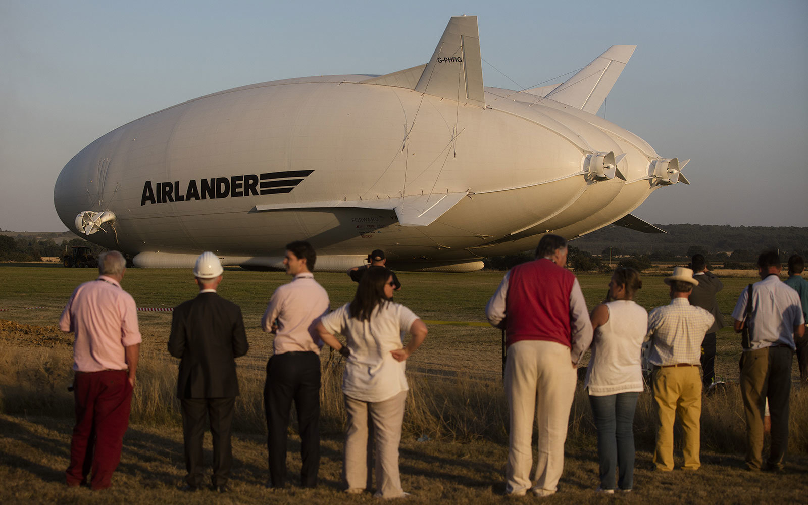 A crowd gathers at the Airlander's maiden flight in England.