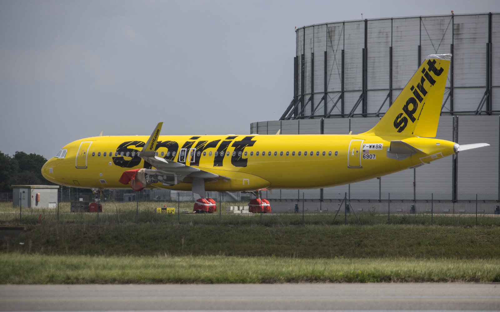 A Spirit Airlines aircraft sits at the airport.