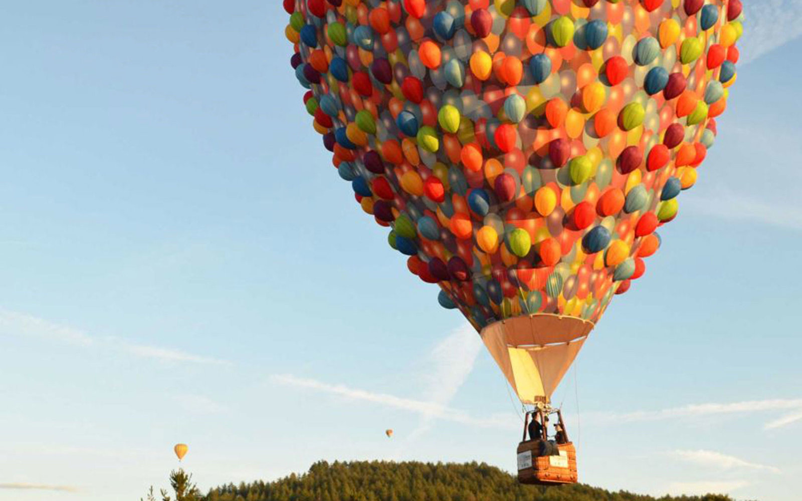 the balloon house from disney s up is flying over australia