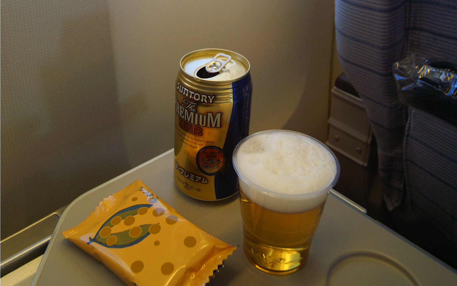 beer on an airplane tray table