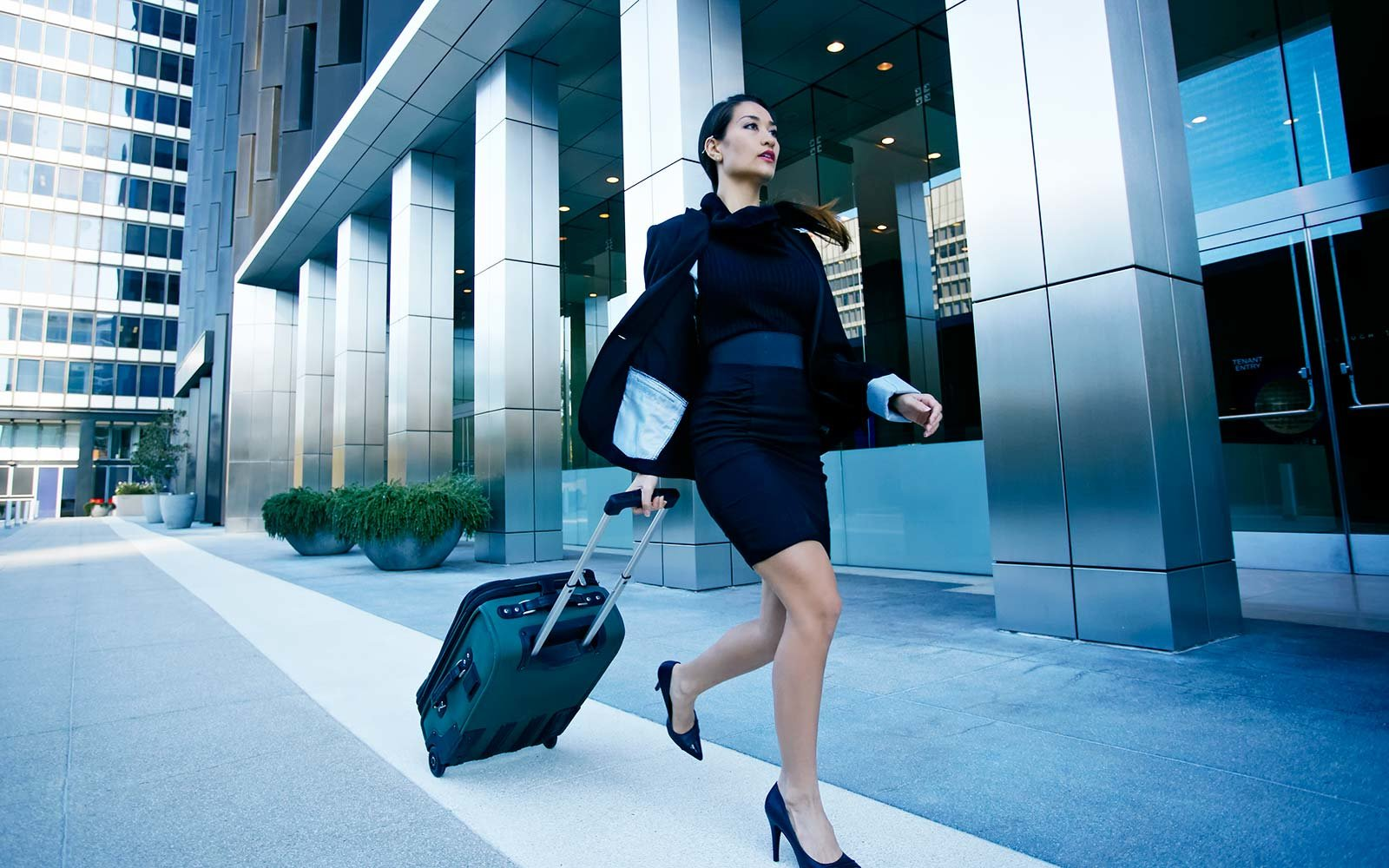 Business female luggage suitcase Business Travel