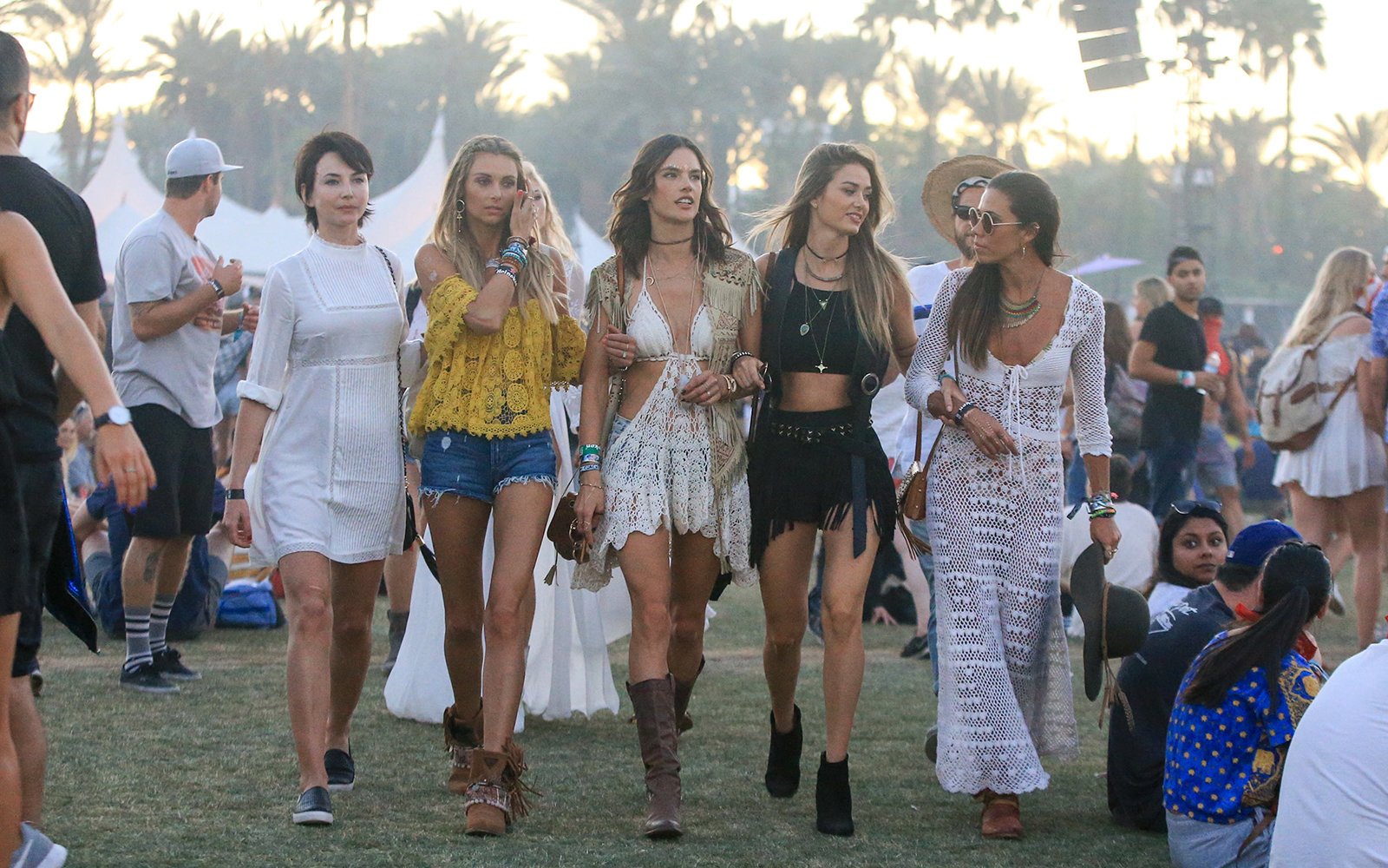 Celebrities walking through Coachella music festival