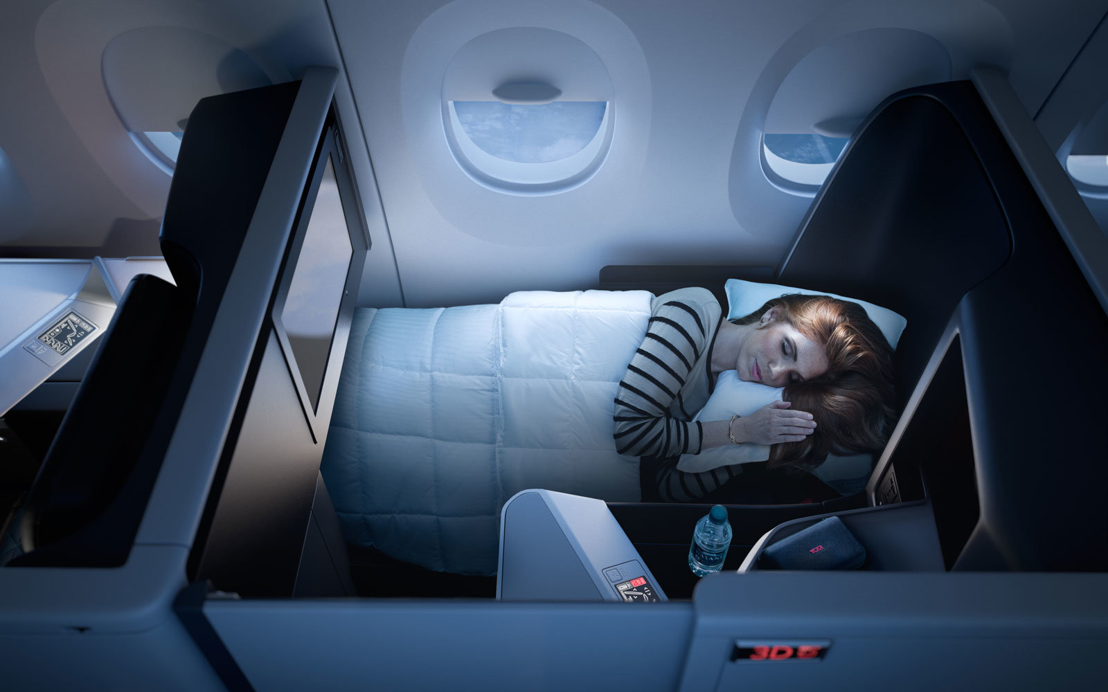 A passenger sleeps in a Delta suite on the A350.