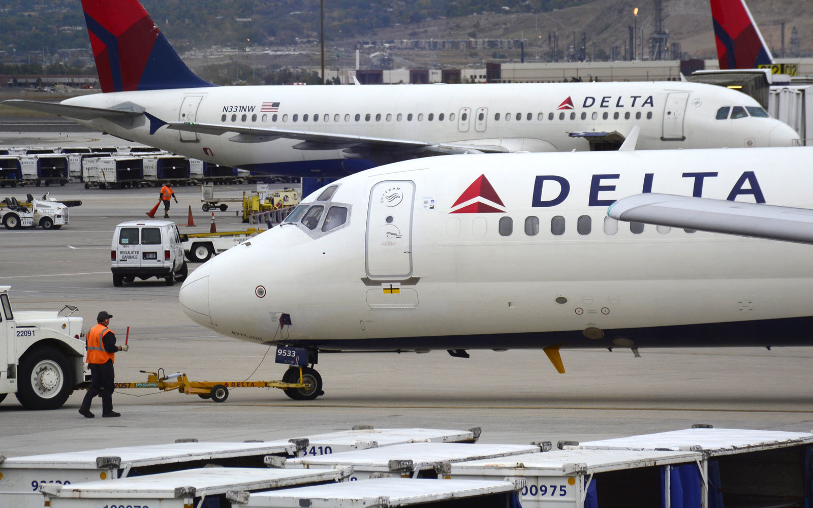 A Delta plane at the airport.