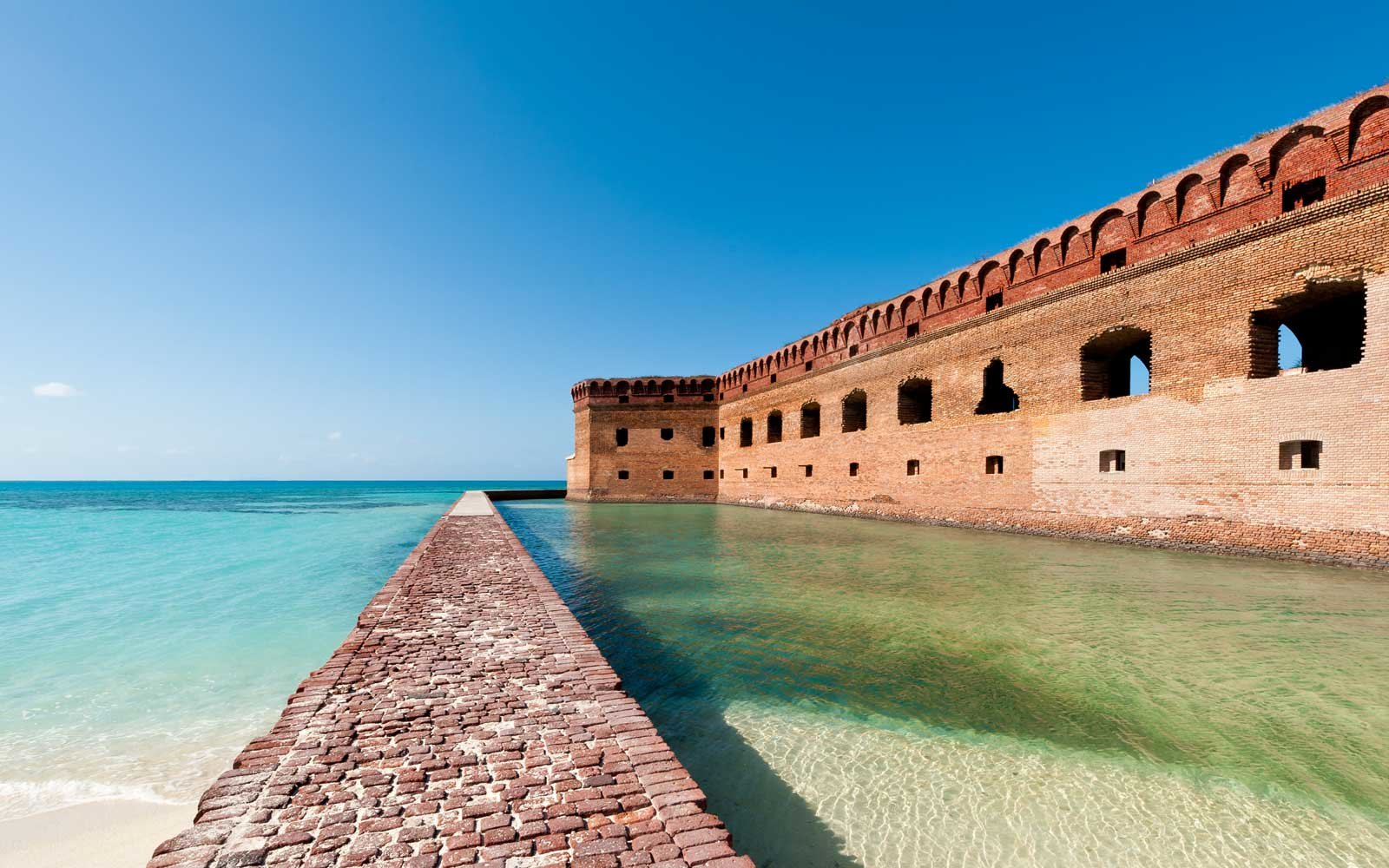 Dry Tortugas National Park is known for its clear blue waters, marine life, and historic structures like Fort Jefferson.
