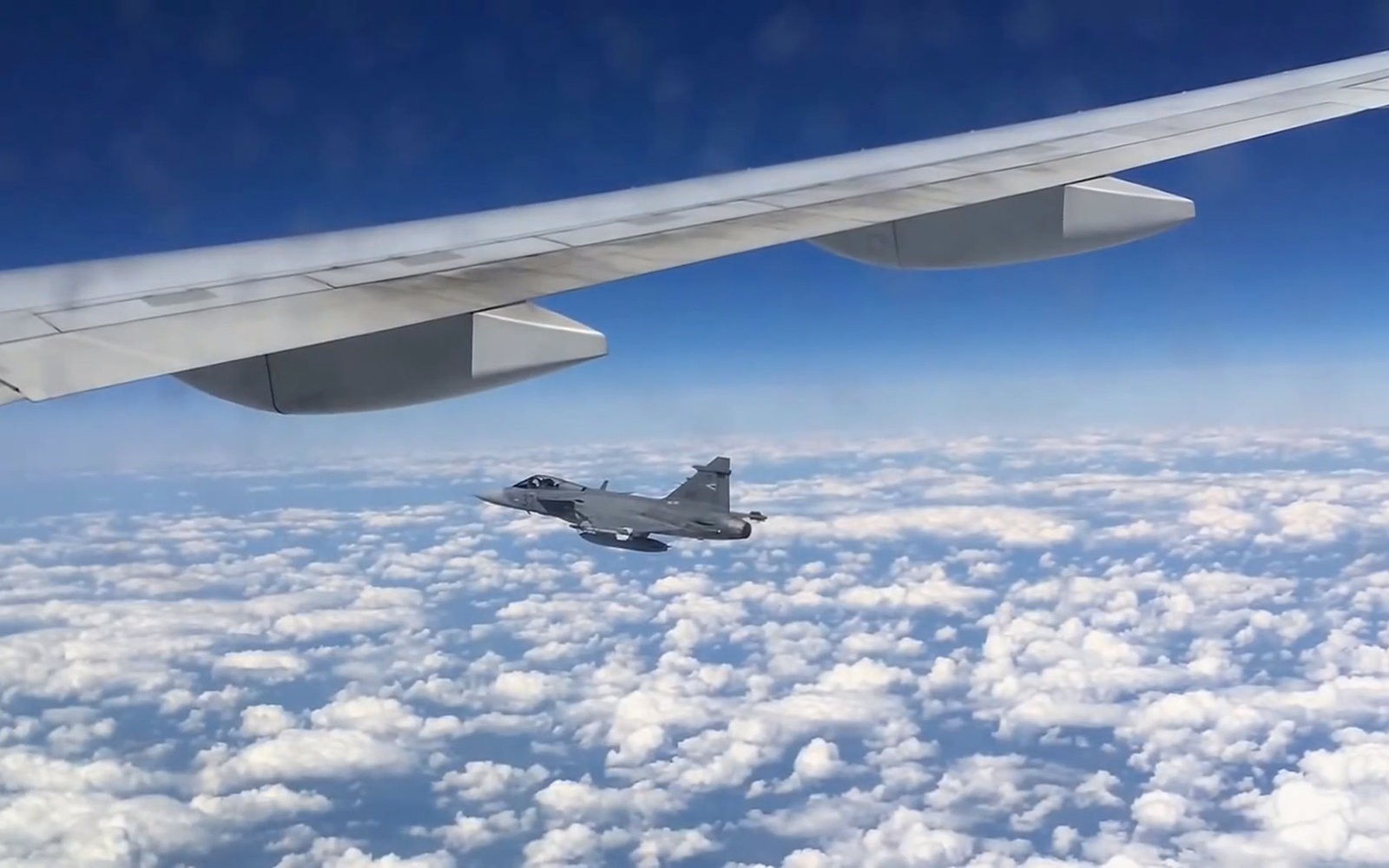 Fighter Jet seen from commercial airplane