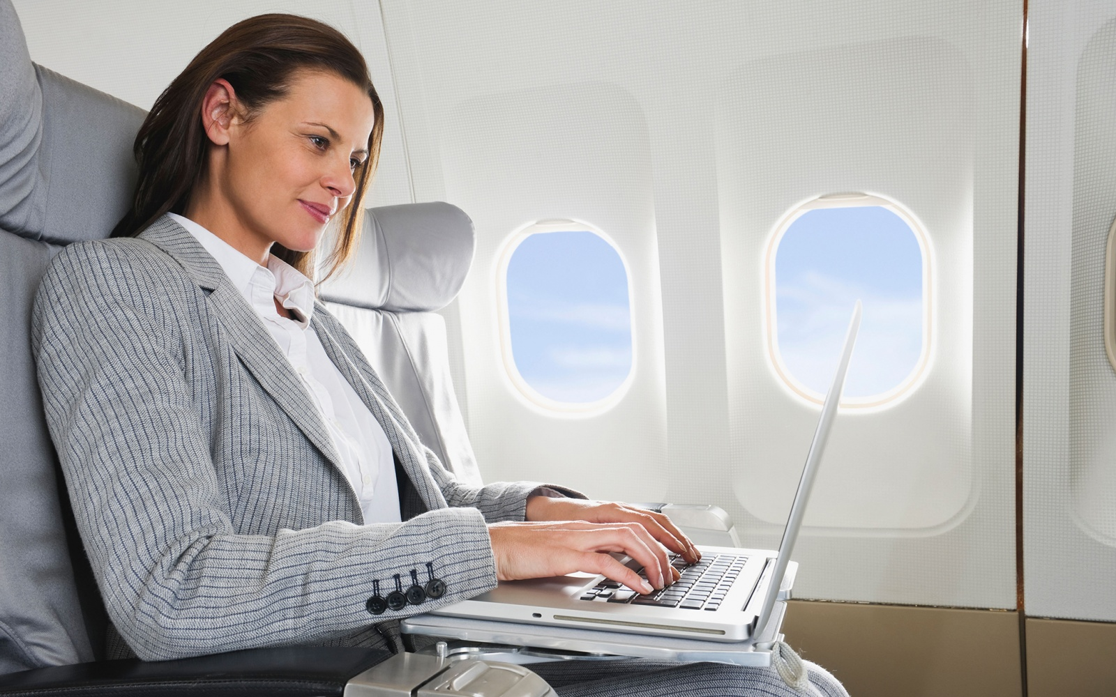 Woman on Laptop on Airplane