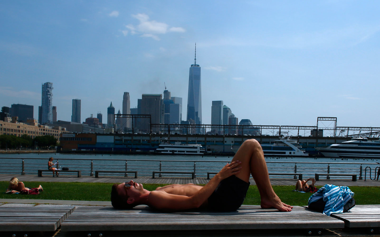 Man lies in the sun in NYC.