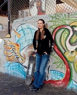 Melissa Thaw, skateboarder by night, in Portland's Burnside Skate Park, built by boarders.