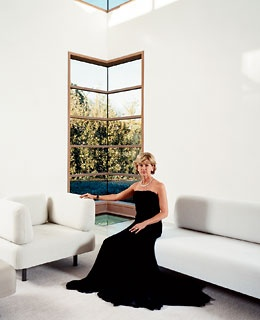 Marguerite Hoffman in her Andree Putman-designed gallery space. Gown by Badgley Mischka; jewelry, Harry Winston.