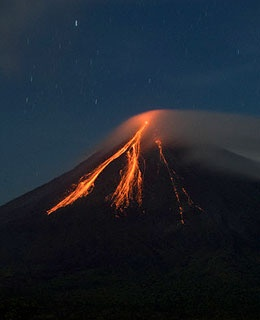 volcano with flowing lava at night in La Fortuna, Costa Rica