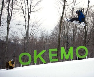 snowboarder in the air in Okemo ski resort, Vermont