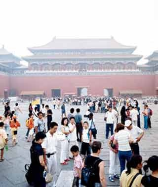 Tourists gather in the Forbidden City, which is now being extensively restored.