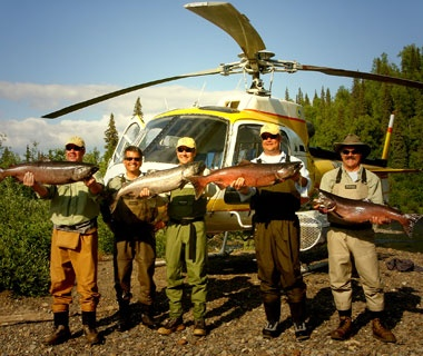 fisherman with their catch in front of a helicopter, Alaska