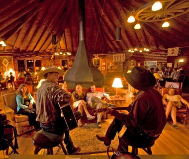 cowboys playing guitar at A Bar A Ranch in Encampment, WY