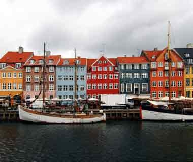 fishing boats and colorful homes in Copenhagen, Denmark