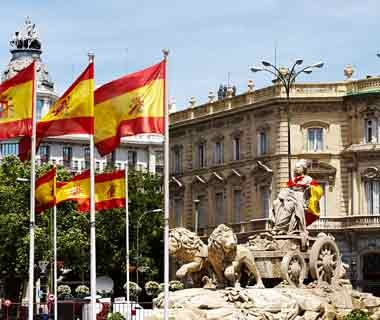 statue and flags in Madrid, Spain