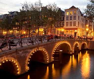 canal bridge with lights in Amsterdam, The Netherlands