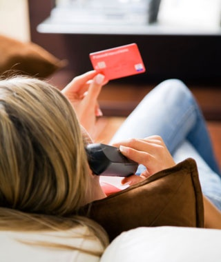 a woman holding her credit card
