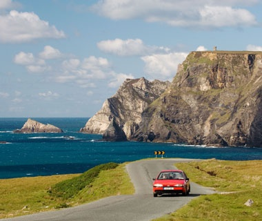 rental car driving on the Irish coast