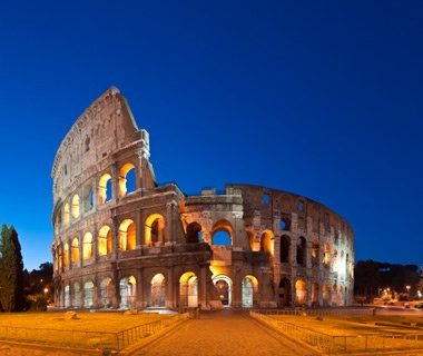 outside the Colosseum at night in Rome, Italy