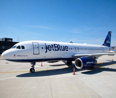 JetBlue airliner at airport terminal