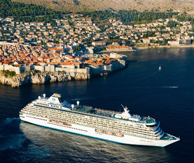 Crystal cruise ship in a city harbor