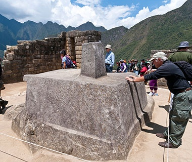 Rubbing the Intihuatana Stone, Peru