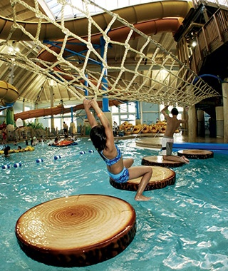 Indoor pool with waterslide  America's Coolest Indoor Water Parks | Travel + Leisure