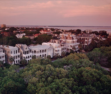 Sunset over homes in Charleston, SC