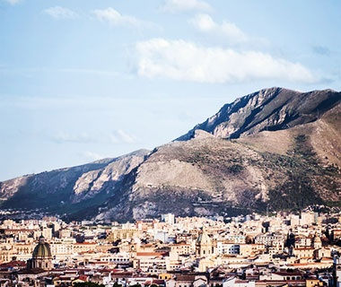 Palermo in front of mountains in Sicily, Italy