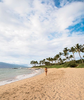 walking along the beach at Mokapu Beach in Maui, Hawaii