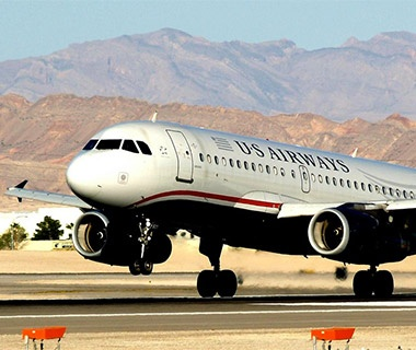 US Airways airplane landing on the runway