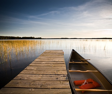 canoe and pier in Deer Lake, MN