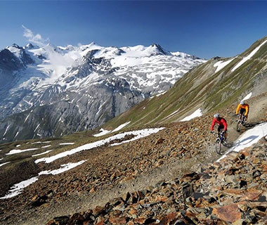 mountain biking in the Alps in Switzerland and Italy