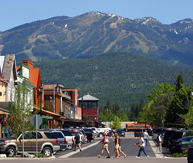 mountains over the town streets in Whitefish, MT
