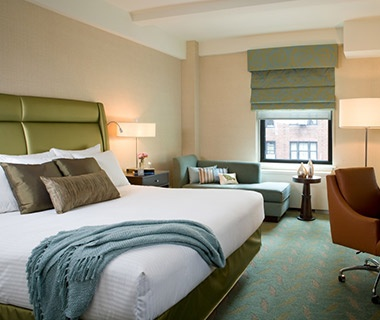 guest bed at Affinia Shelburne hotel in New York City, NY
