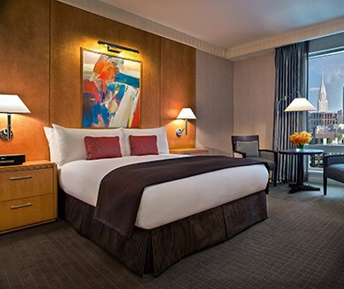 guest bed at Sofitel hotel in New York City, NY