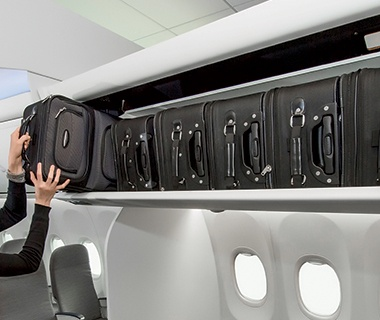carry-on suitcase stored in overhead bin on an airplane