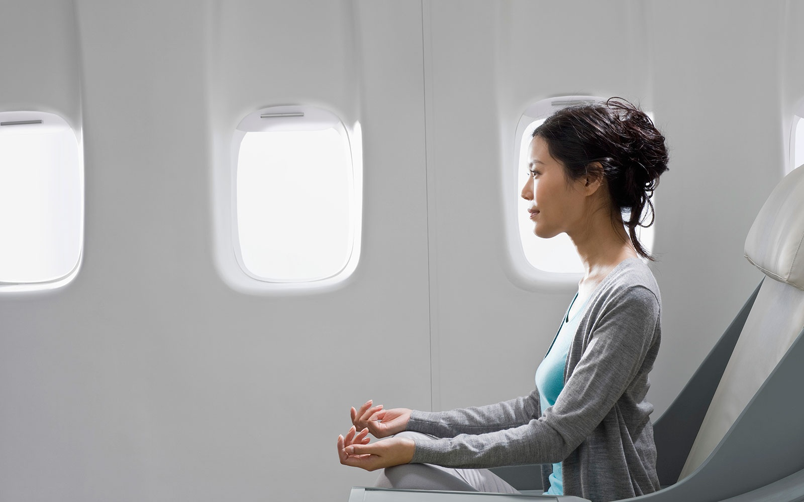 woman mediating on a flight