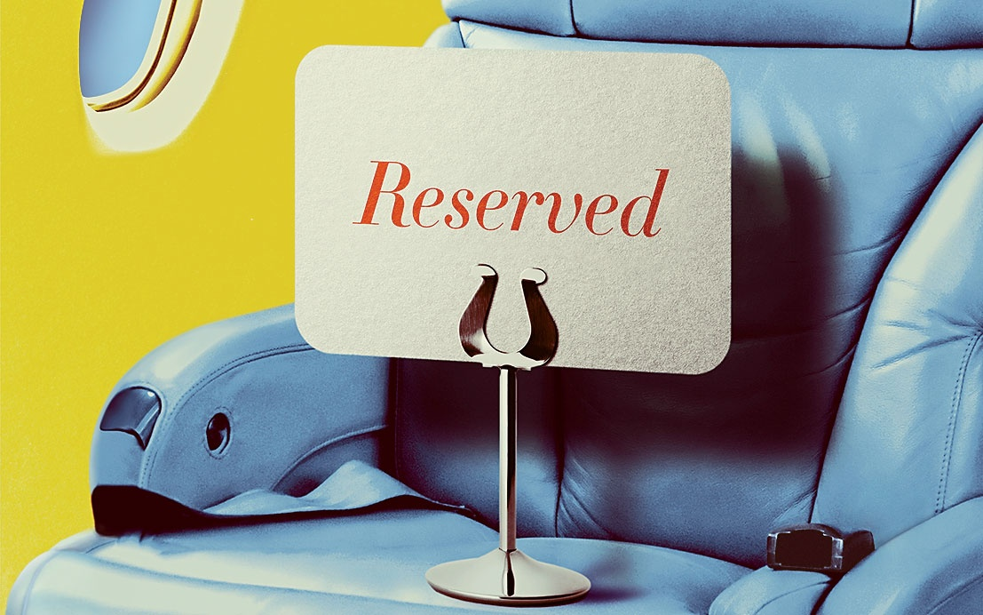 Reserved sign on Business Class airplane seat