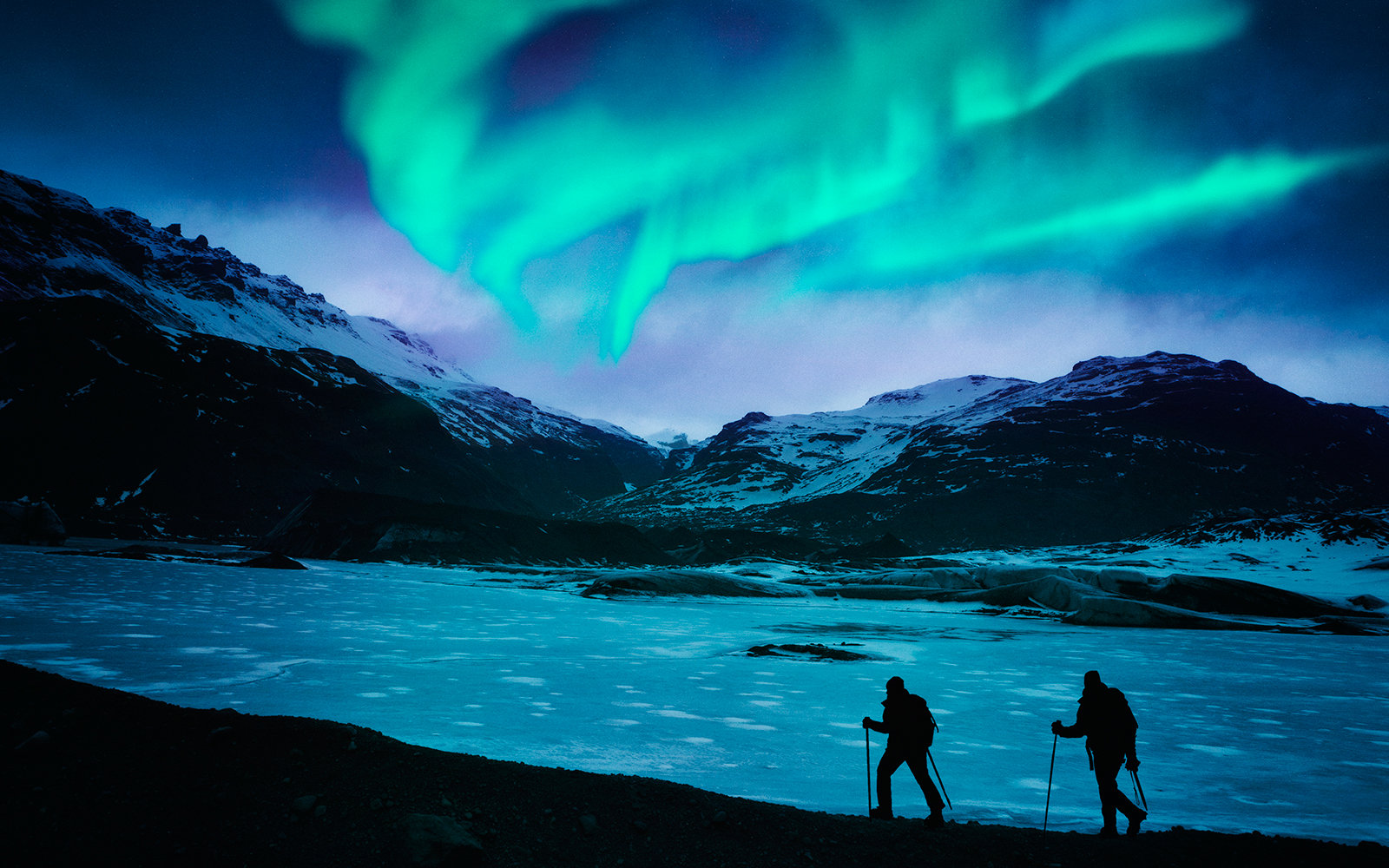 Hikers Under Northern Lights