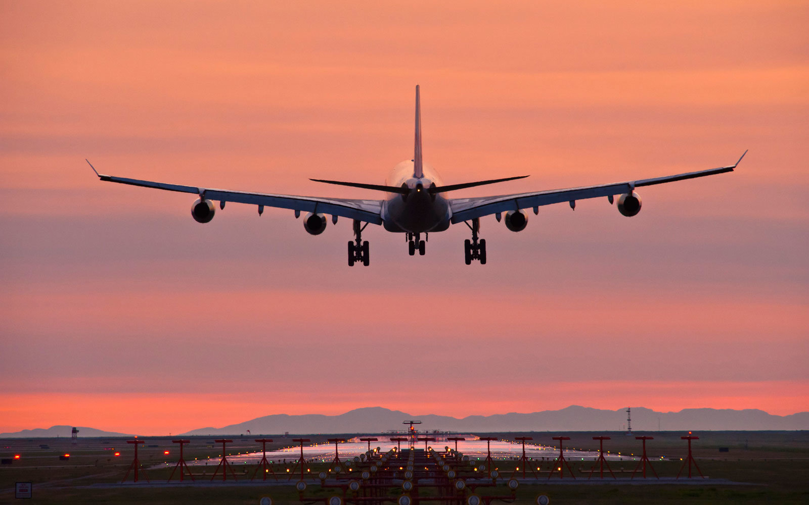 A plane landing on the runway.