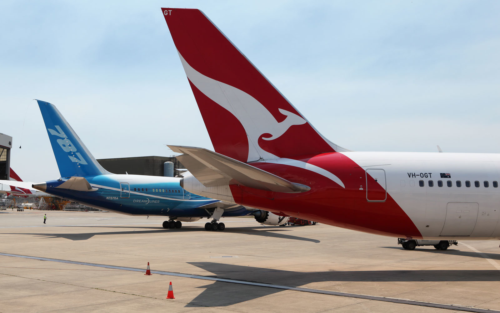 A 787 next to a Qantas aircraft.