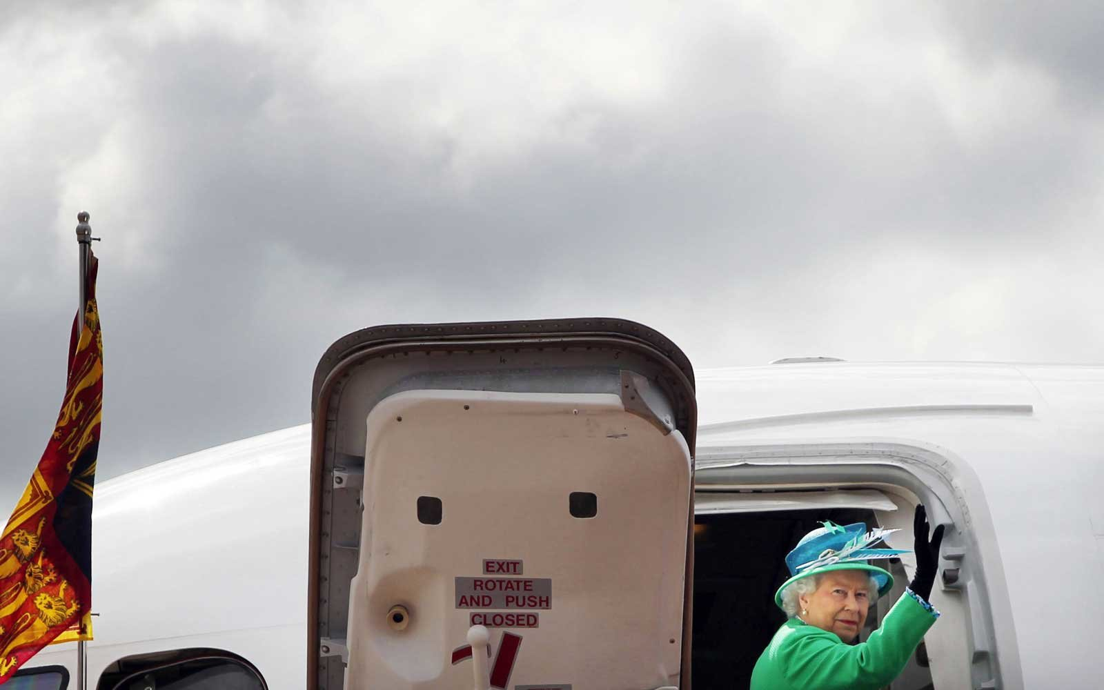 Queen Elizabeth II boards an airplane