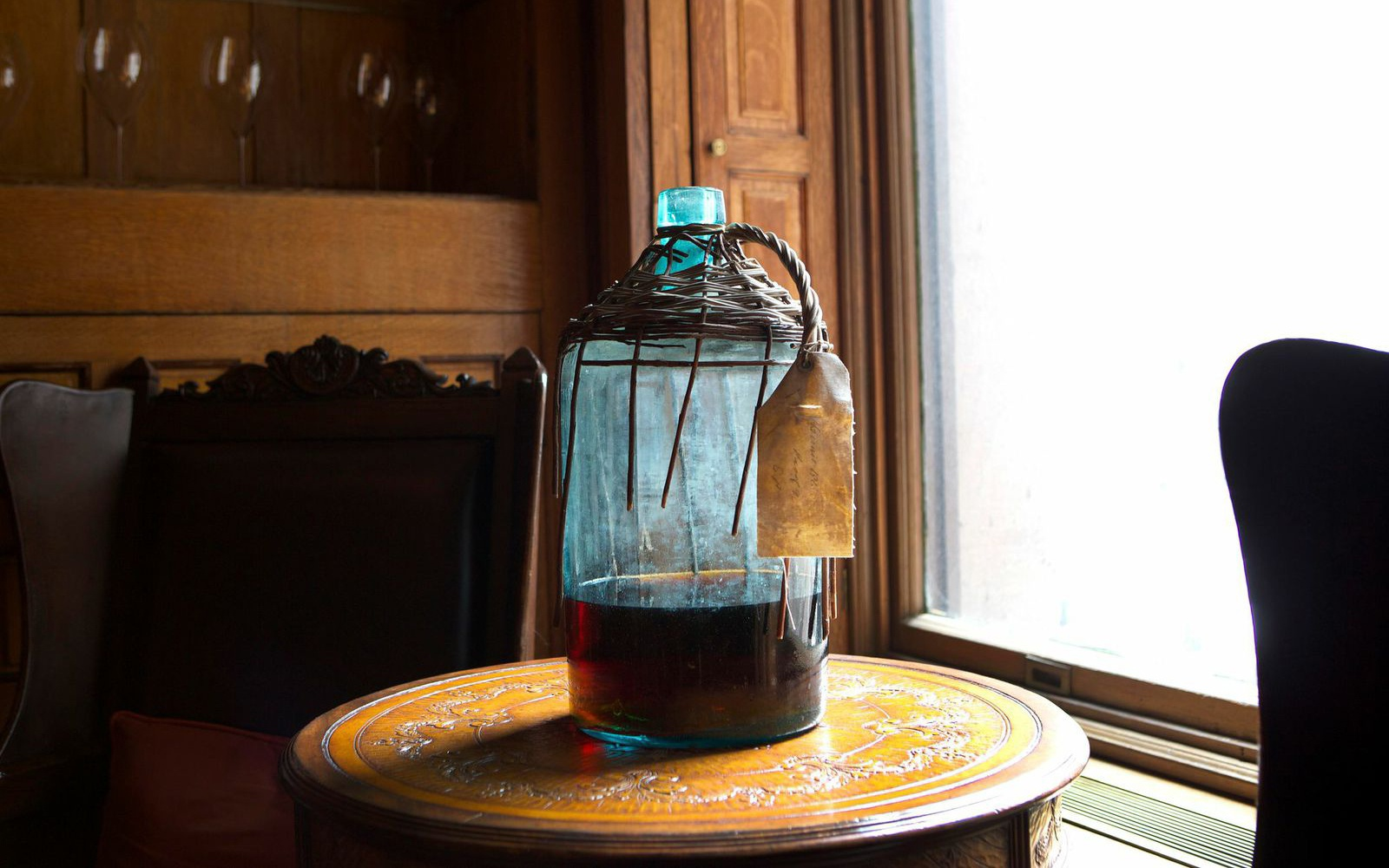 Glass jug on table near window