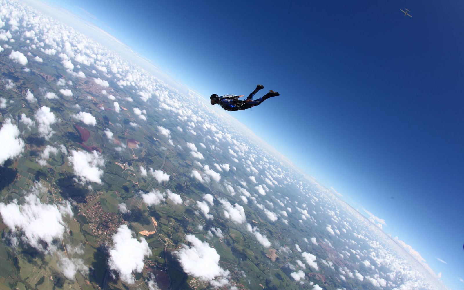 A skydiver high above the Earth.