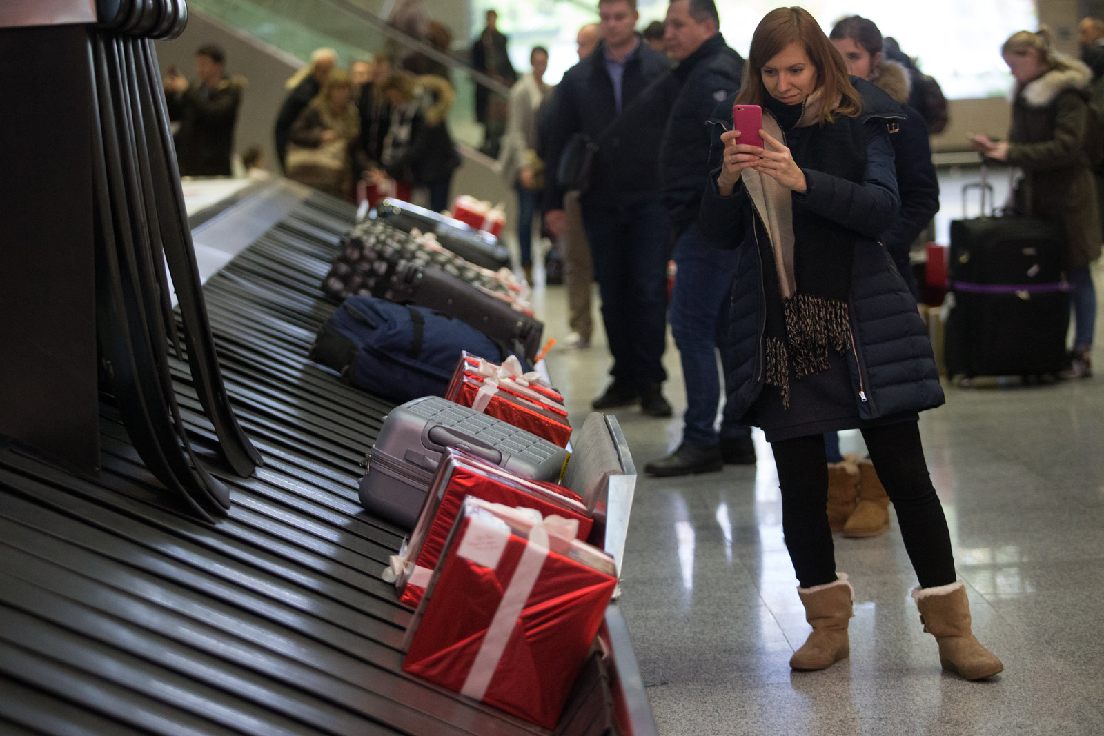 Presents on airport conveyer belt with baggage