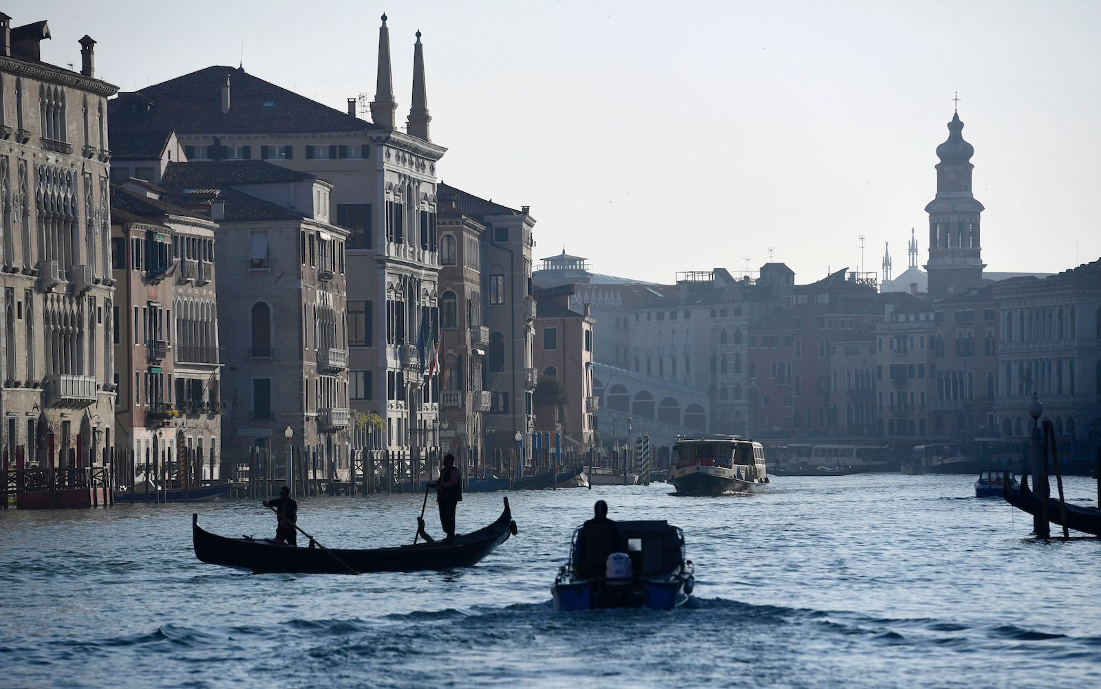 A Venice gondoliere makes his way down the Grand Canal.
